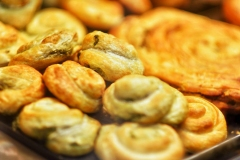 Close-up of freshly baked sliced burek pie with meat stuffing, top view