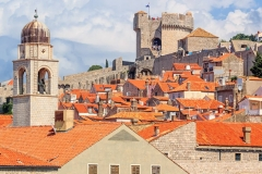 Summer mediterranean cityscape - view of the roofs of the Old Town of Dubrovnik on the background on of the city walls and of the Minceta Tower, Adriatic coast of Croatia