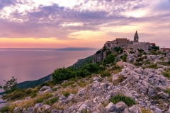 The famoud Lubenice village at sunset over the sea in Cres island Croatia